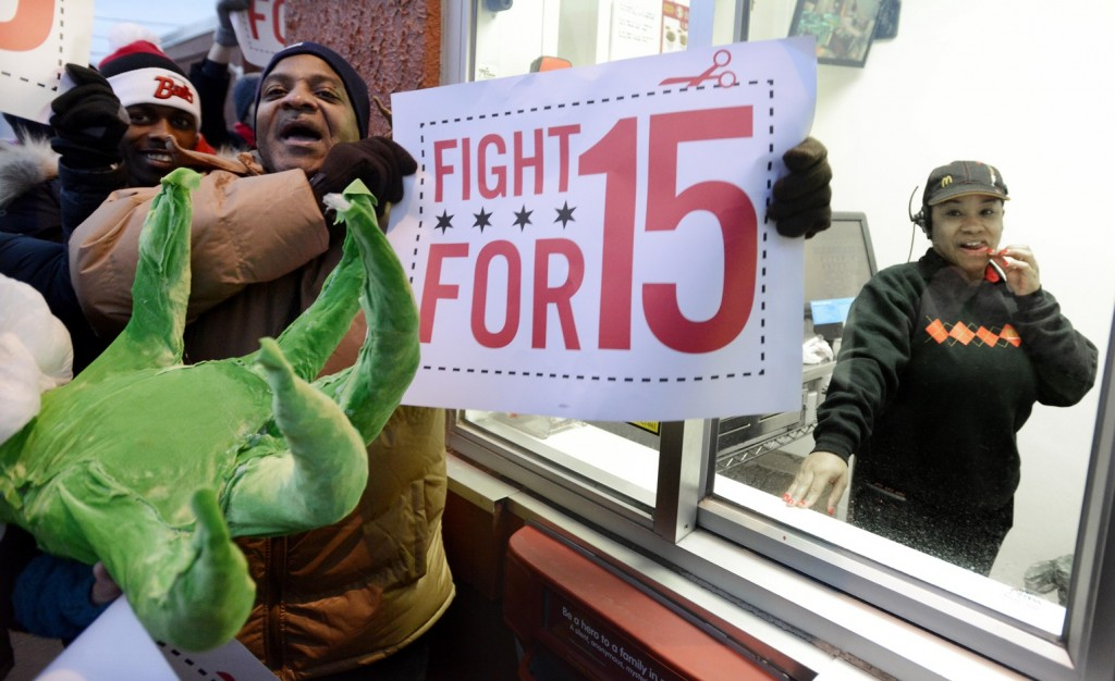 Demonstrators rally for better wages outside a McDonald's restaurant in Chicago on Thursday. Demonstrations planned in 100 cities were part of push by labor unions, worker advocacy groups and Democrats to raise the federal minimum wage of $7.25.