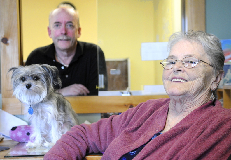 retiring: Mike and Lynda McFarland, shown here with their dog, Moka, who joins them at work daily, plan to retire Dec. 20 as Greyhound bus agents. The couple have sold tickets for 35 years in Augusta, currently at the Augusta State Airport.