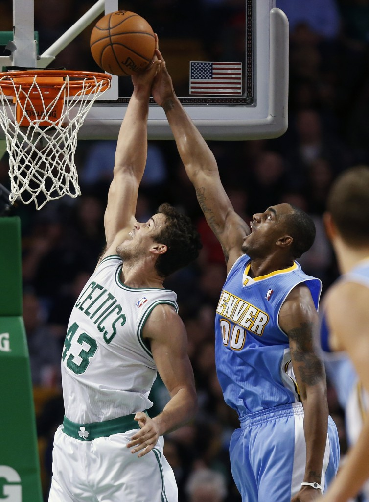 BLOCKED: Denver Nuggets' Darrell Arthur (00) blocks a shot by Boston Celtics' Kris Humphries (43) in the second quarter of a game on Friday in Boston.