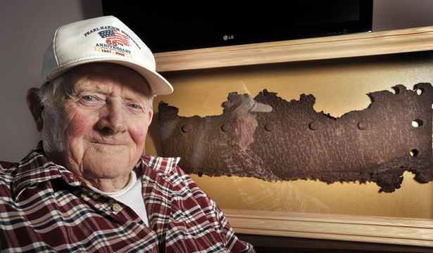 Bert Davis, a Navy veteran who lived through the attack on Pearl Harbor, is shown in 2012 with a rusted piece of steel from the USS Arizona that was unveiled on Dec. 7 at a ceremony at the Maine Veterans Home in South Paris.
