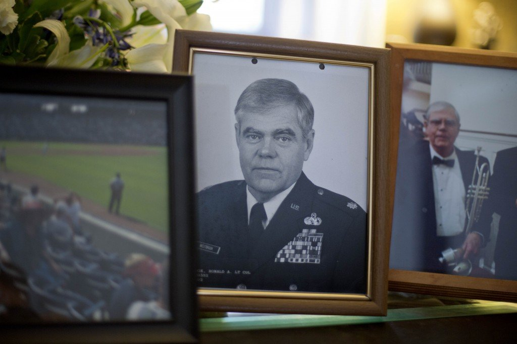 A photo of Ret. Lt. Col. Ronald Westbrook sits on the coffee table in his home, Thursday, Dec. 5, in Chickamauga, Ga. His life ended when he wandered away from home, pounded on a stranger's door and was shot and killed by the resident.