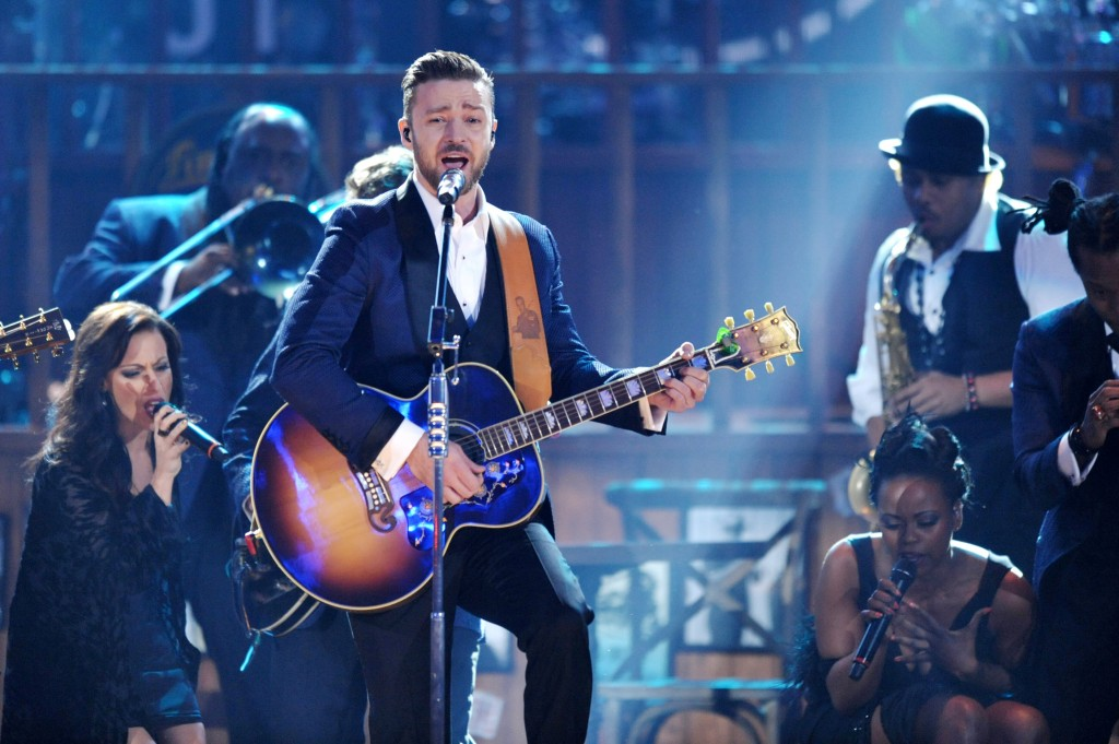 FILE - In this Nov. 24, 2013 file photo, Justin Timberlake, center, performs on stage at the American Music Awards at the Nokia Theatre L.A. Live in Los Angeles. Timberlake is among the clear favorites as The Recording Academy prepares to unveil its Grammy nominees on Friday, Dec. 6, 2013. A handful will be unveiled during a CBS special, and the rest announced after it airs.