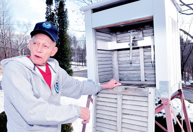 CHECKING IT TWICE: Dennis Pike explains how he monitors weather conditions including the high and low temperatures from thermometers inside this container each day of the year at his home in Farmington. For decades Pike has recorded weather factors for NOAA, National Oceanic Atmospheric Administration.