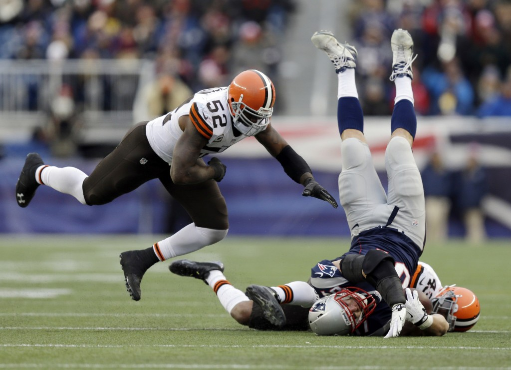 Cleveland Browns safety T.J. Ward (43) and linebacker D'Qwell Jackson (52) tackle Rob Gronkowski of the Patriots after a catch in the third quarter Sunday at Foxborough, Mass. Gronkowski hurt his leg on the play and was carted to the locker room.