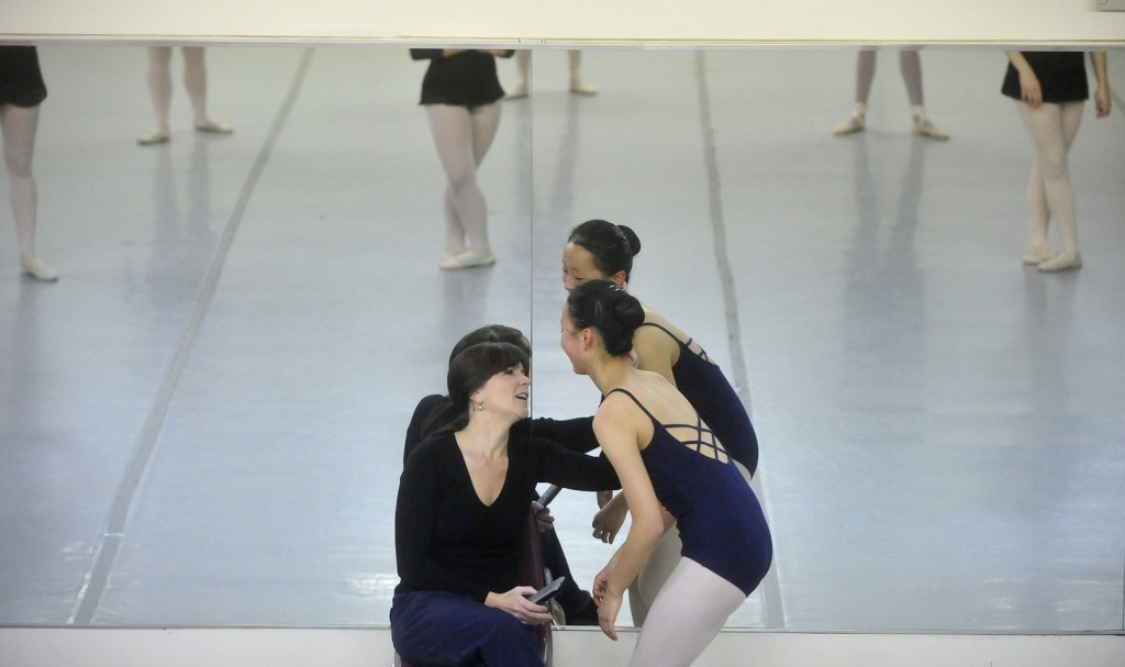 "BOSSOV BALLET: Natalya Getman, left, shares a moment with Maine Central Institue sophomore Diyun Wang, 16, during a rehearsal for ""The Nutcracker"" last week. The Bossov Ballet Theatre is now a part of the Pittsfield school. Getman is the company's new artistic director, succeeding Andrei Bossov."