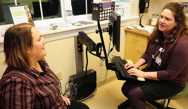 MEDICAL CHOICES: Crystal Beaulieu, left, talks with Dr. Michelle Mosher during an office visit on Friday at Winthrop Family Medicine in Winthrop, which recently received a grant that encourages physicians to talk to patients about conducting tests only when they add value to a diagnosis.