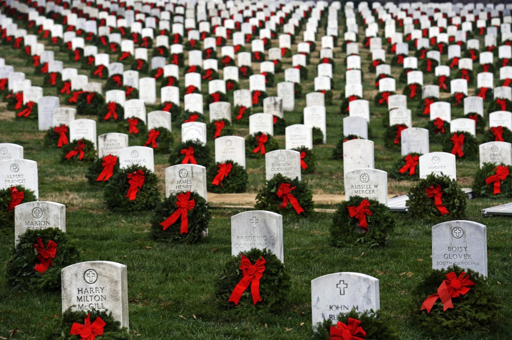 Wreaths donated by Worcester Wreath Company of Harrington, Maine, are placed next to headstones at Arlington National Cemetery in Arlington, Va., in this 2010 photo.