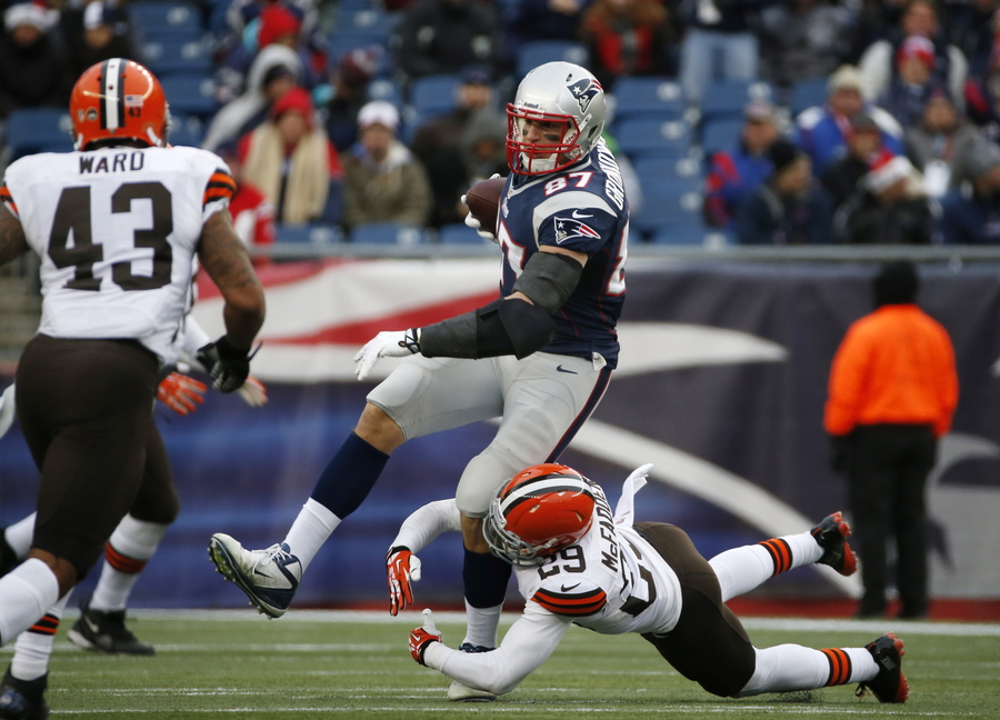 New England Patriots tight end Rob Gronkowski is tackled by Cleveland Browns cornerback Leon McFadden during the third quarter of Sunday's game in Foxborough, Mass. Gronkowski suffered a season-ending injury during the game.