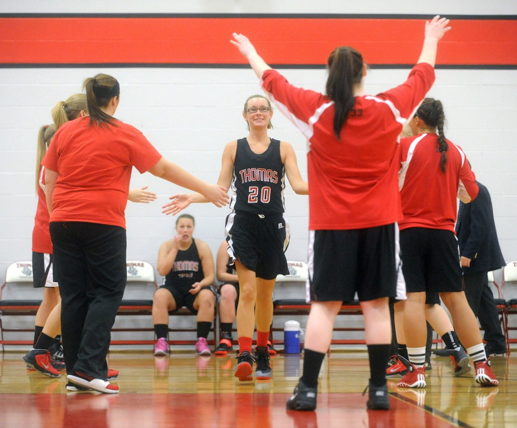 Staff photo by Michael G. Seamans COLLEGE BASKETBALL: Emily Reynolds is announced in pre-game against Johnson State at Thomas College in Waterville on Saturday, Dec. 7, 2013.