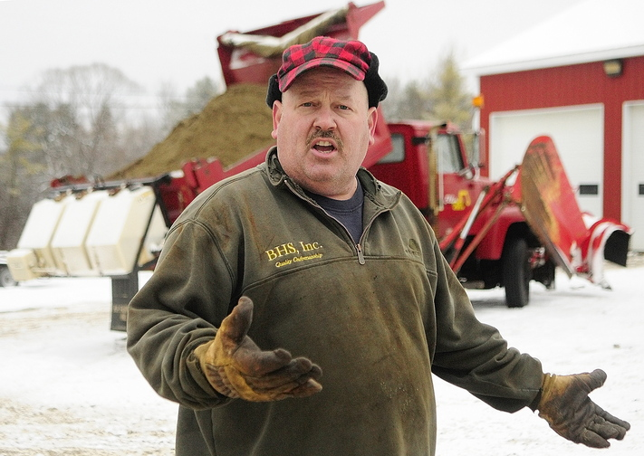 Contracted: Chris Ellis talks about the calcium chloride dispensers on his plow trucks on Tuesday.