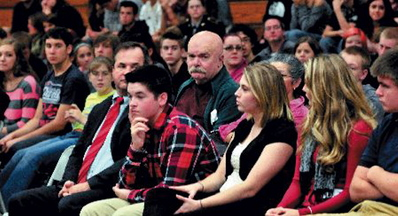 appeal Fails: Al Althenn, center, of China, looks at Nokomis Regional High School student Katie Manzo, at right, as she asks questions during a break in hearings in October at the Newport school with Justices of the Maine Supreme Judicial Court.