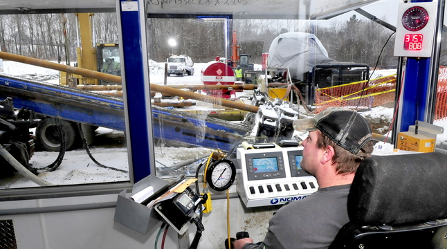 HERE'S THE DRILL: From inside a control building, operation engineer Terry Weber of Nomad Pipeline Services monitors the progress of a drill that is boring a 2,000-foot hole for a natural gas pipeline from Winslow under the Kennebec River to Waterville and Thomas College.