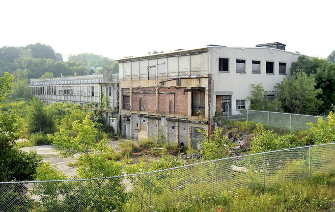 The boarded-up Keddy Mill on Depot Street in Windham occupies the site where an estimated 55,000 tons of material contaminated with PCBs are buried.