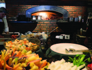 A brick oven helped create delicious pizza.