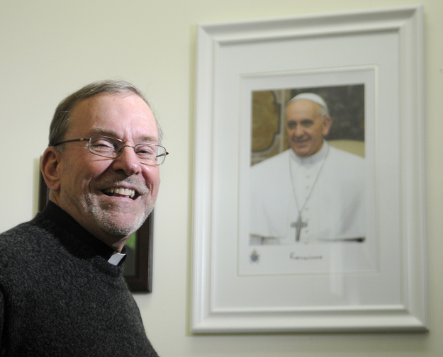 Committed: The Rev. Francis Morin, the administrator of St. Michael Catholic Parish in Augusta, said he is excited by the recognition Pope Francis has generated because of his commitment to social justice. The pontiff was named Time magazine's Person of the Year.