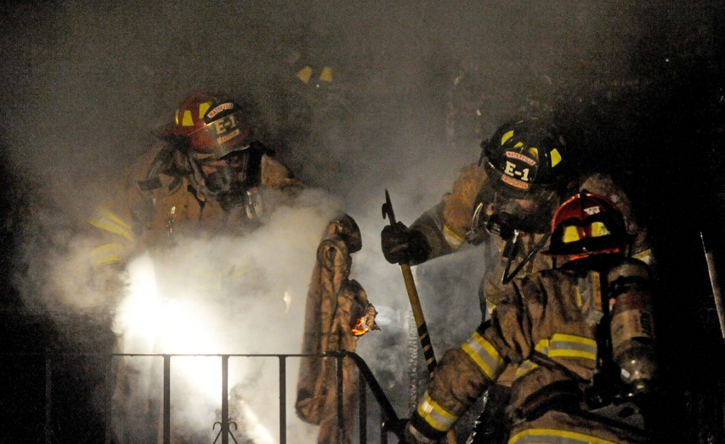 STRUCTURE FIRE: Firefighters from Waterville battle a blaze at 1 Mount Pleasant St. in Waterville on Wednesday night.