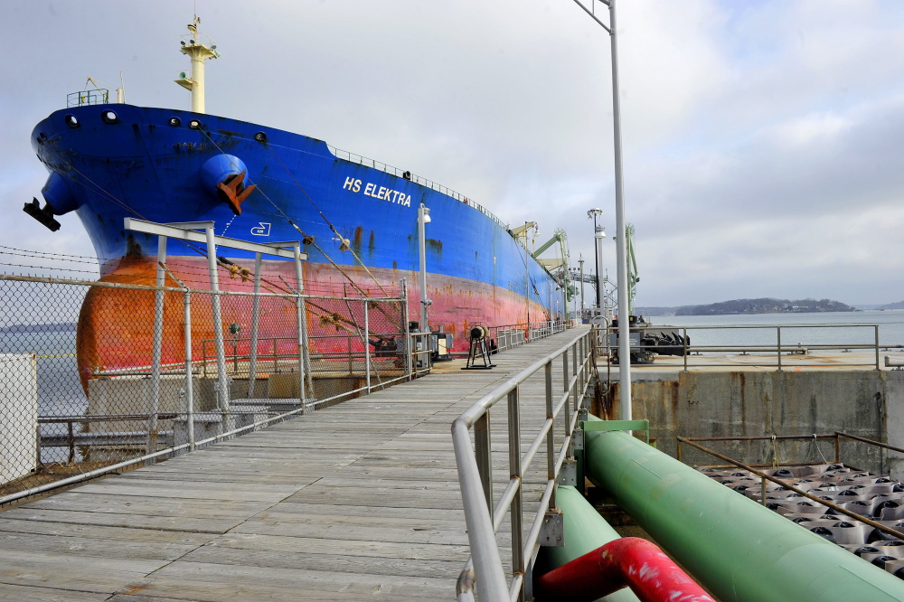 A tanker unloads at the Portland Pipe Line facility earlier this year. If a reversal is allowed, the 236-mile underground pipeline could be used to transport so-call tar sands crude from reserves in the province of Alberta to South Portland.