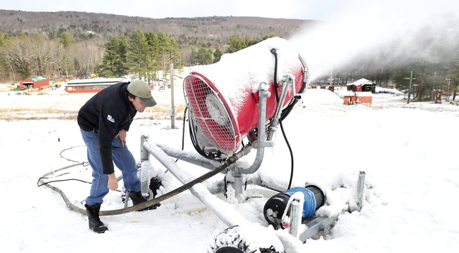 SNOW MAKER: Dave Beers re-directs his snow-making equipment Wednesday as he gets Eaton Mountain in Skowhegan ready for its opening Saturday.