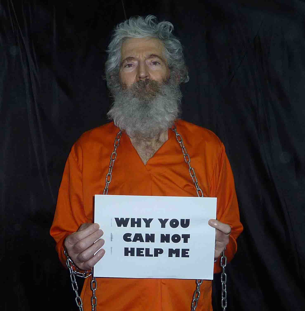 There has been no hint of Robert Levinson's whereabouts since his family received proof-of-life photos, one of which is above, and a video in late 2010 and early 2011.