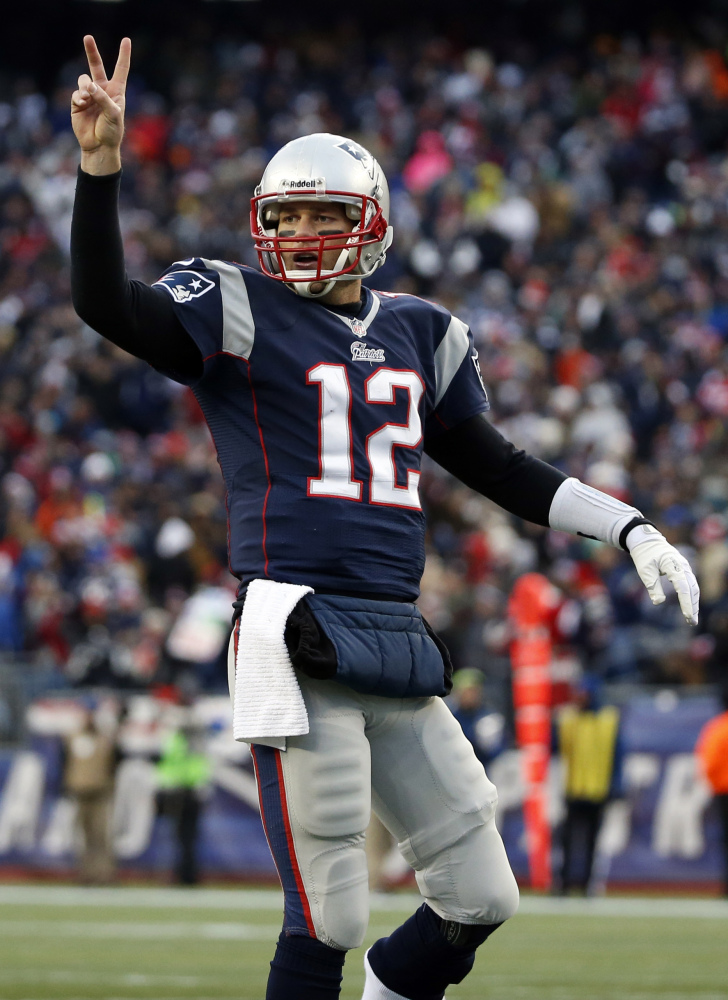 TITLE UP FOR GRABS: TOm Brady and the New England Patriots can clinch the AFC East with a win over the Miami Dolphins on Sunday.