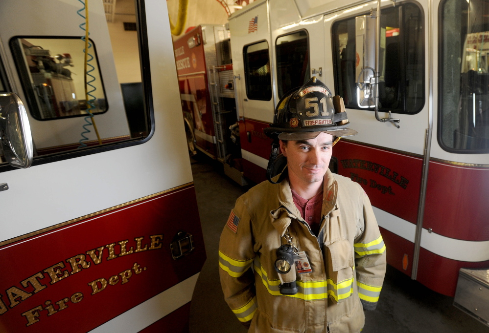 Staff photo by Michael G. Seamans FIRE RESCUE: Mark Hamilton, a reuse technician with the Waterville fire department is being credited with rescuing a man from the basement of an apartment building fire on Mount Pleasant Street in Waterville on Wednesday night.