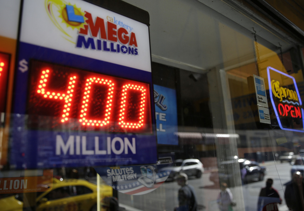 A sign displaying the current Mega Millions jackpot is shown at a Financial District liquor store Thursday, Dec. 12, 2013, in San Francisco. Lottery officials behind Mega Millions say the lesser known game alongside Powerball is grabbing some attention with an estimated $400 million jackpot, an estimated amount that comes less than two months after a major revamp to the game. The estimated jackpot is the fifth largest ever and second largest in Mega Millions history, trailing behind the $656 million Mega Millions jackpot in 2012.