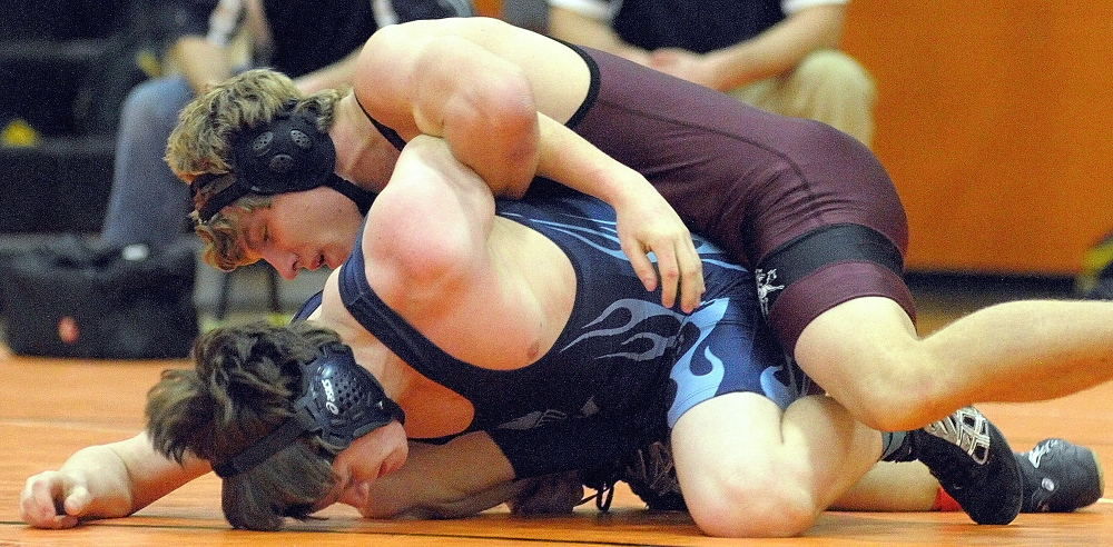 Monmouth Acadmey's Stuart Buzzell, top, would eventually pin Westbrook's Kyle Hanson to wind their 145-pound championship semi-final matchduring the Tiger Invitational on Saturday December 14, 2013 in the John A. Bragoli Memorial Gym in Gardiner.