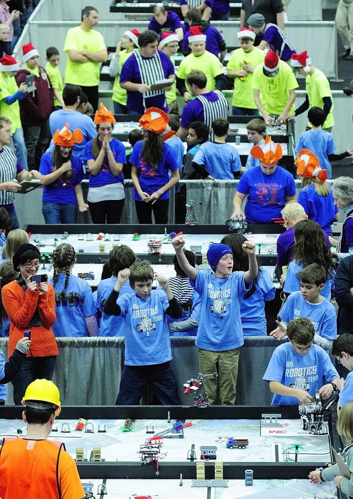 COMPETITION: Teams cheer as their robots perform tasks on tables during Maine's FIRST® LEGO® League Championship at the Augusta Civic Center on Saturday.