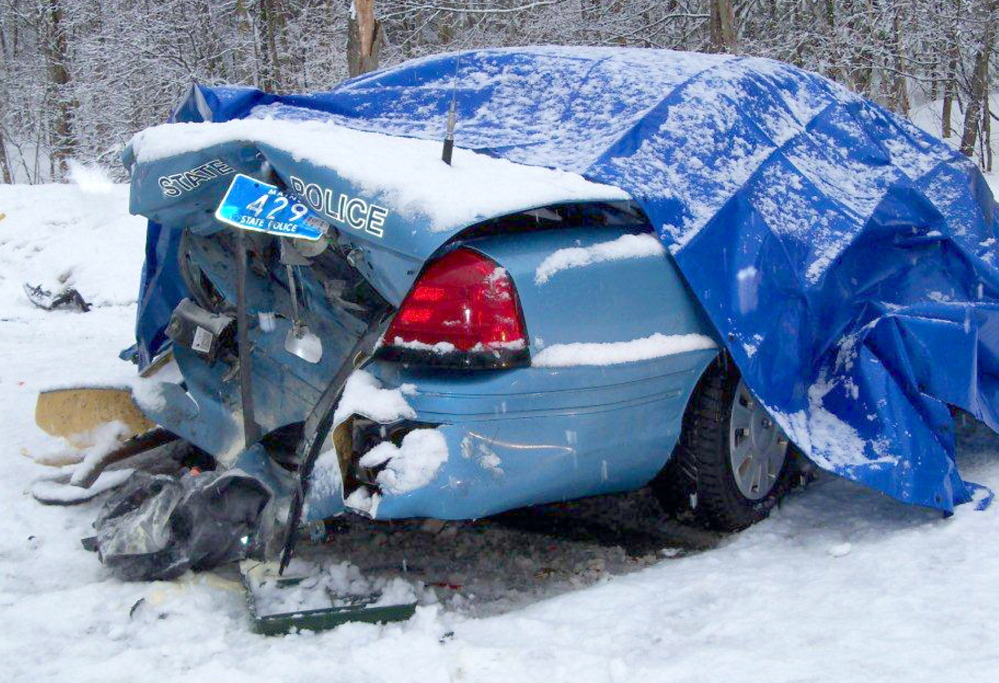 MOVE OVER: State Trooper Robert Cjeka was trapped in his cruiser in March 2011 after his vehicle was rear ended by an empty logging truck while stopped on the side of the road in Livermore Falls. Police are renewing calls for motorists to slow down and move over when approaching an emergency vehicle after several State Police cruisers were struck in recent weeks. Cjeka escaped serious injury.
