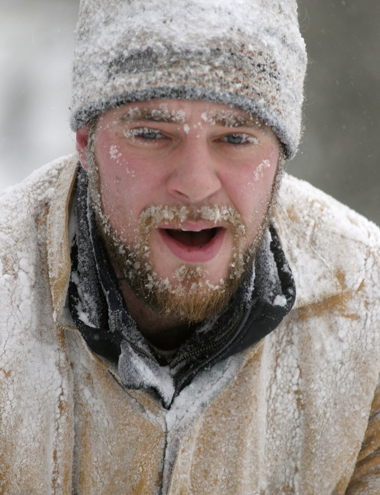 SNOW FACE: Zachary Morse's face and clothes are coated with snow while he shovels out the Unitarian Universalist Community Church on Sunday in Augusta. Morse is the plowing contractor for the church, which canceled its services earlier in the day because of the storm.