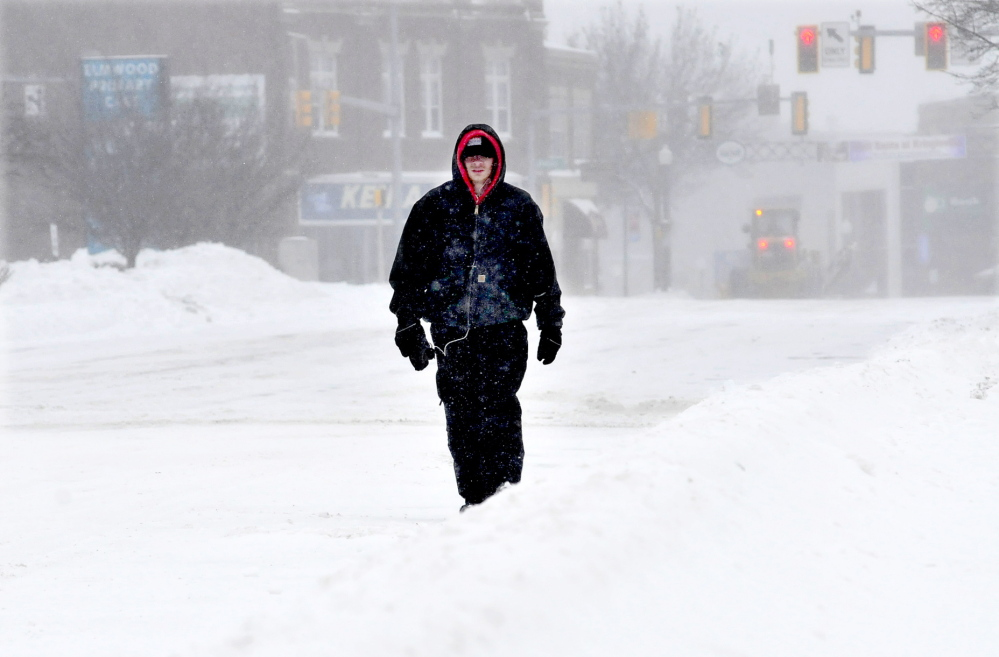 SOLITUDE: Shannon Mullen had Main Street in Waterville to himself as he walked to Waterville Commons to shovel snow on Sunday.