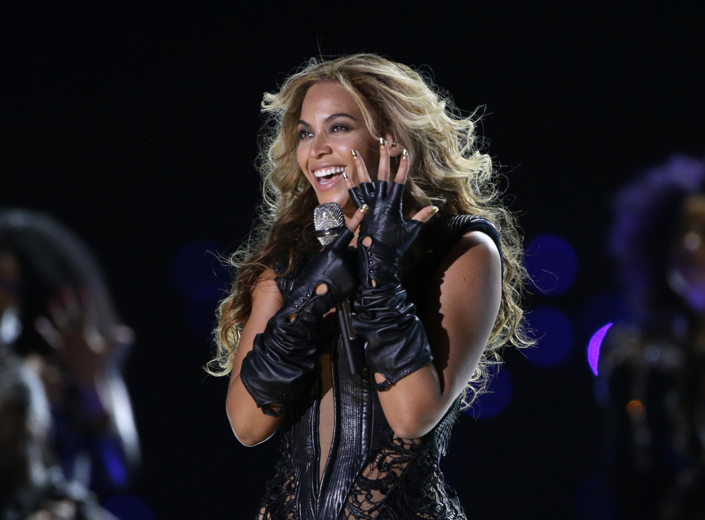 In this Feb. 3, 2013 file photo, Beyonce performs during the halftime show of the NFL Super Bowl XLVII football game between the San Francisco 49ers and the Baltimore Ravens, in New Orleans. Beyonce released her fifth self-titled album exclusively on iTunes early Friday, Dec. 13, 2013.