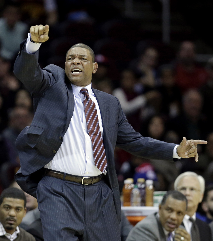 Los Angeles Clippers head coach Doc Rivers reacts during the third quarter of an NBA basketball game against the Cleveland Cavaliers, Saturday, Dec. 7, 2013, in Cleveland. The Cavaliers won 88-82. (AP Photo/Tony Dejak)
