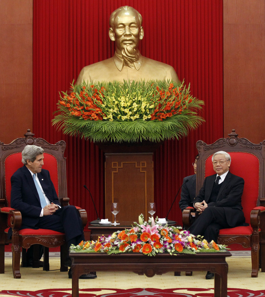 Secretary of State John Kerry meets with Nguyen Phu Trong, general secretary of the Communist Party of Vietnam, in Hanoi on Monday. Kerry pledged up to $18 million in aid to Vietnam, including five fast patrol boats.