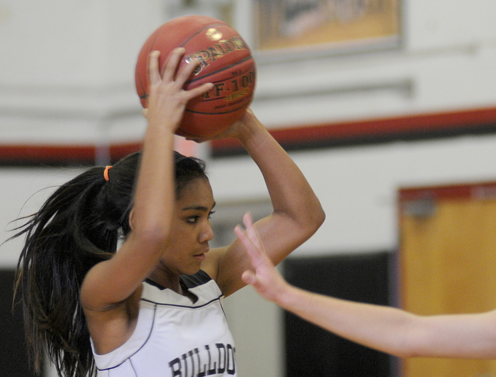 Staff photo by Andy Molloy Madison Area Memorial High School's Tori Mclaughlin, right, blocks Hall-Dale High School's Thea Sweet during a basketball match up Monday in Farmingdale.