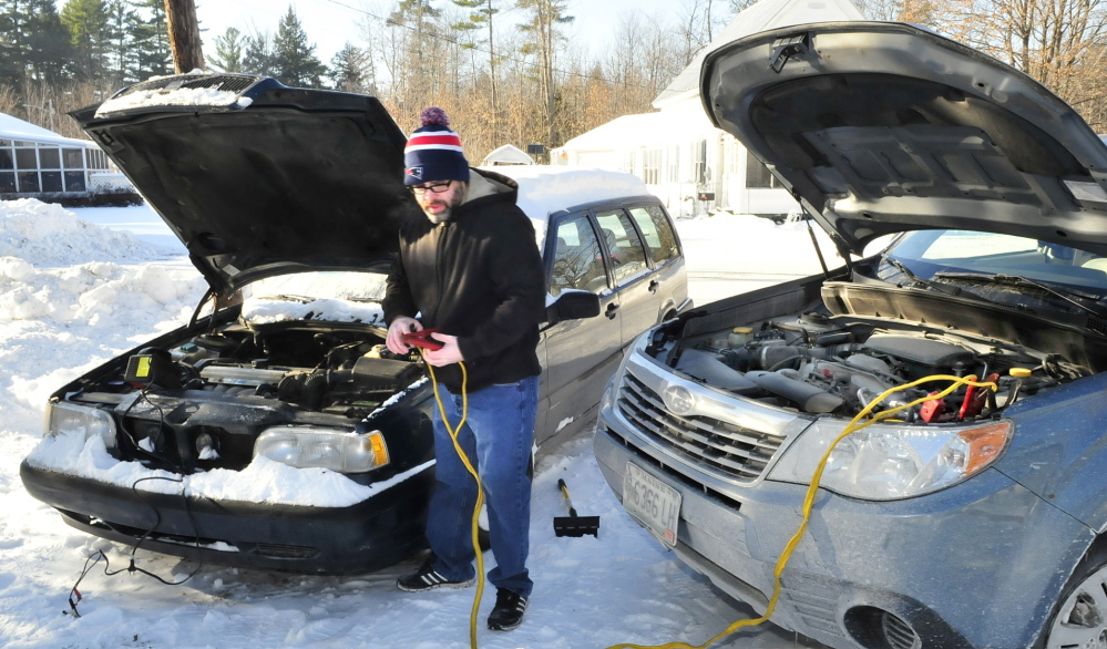 TOO COLD: Below zero temperatures in Skowhegan prevented Job Fitzgerald from starting his car Tuesday, even with the help of a jump start. After repeated attempts Fitzgerald went back inside his warm house.
