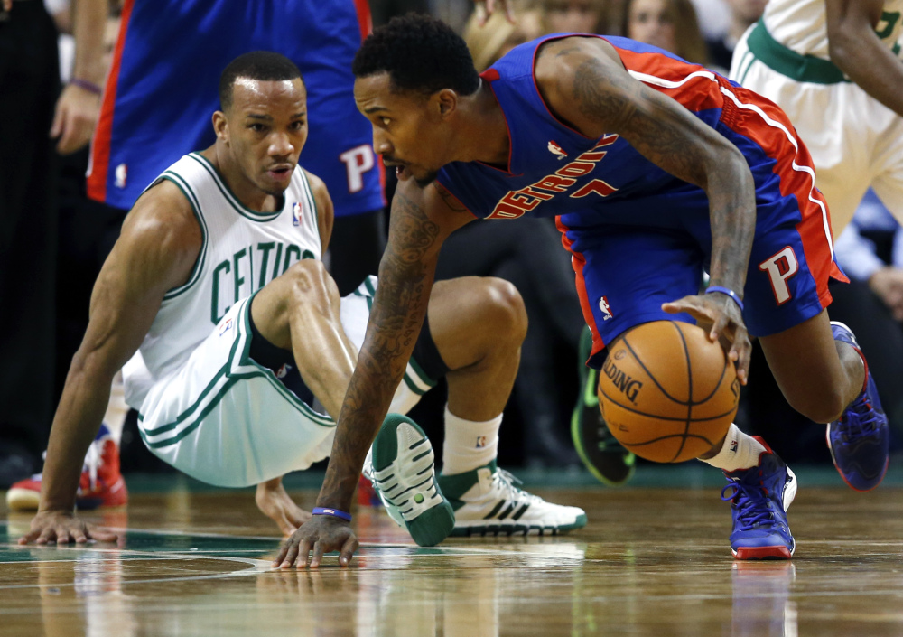 AP photo Detroit Pistons point guard Brandon Jennings (7) controls the ball as Boston Celtics point guard Avery Bradley falls to the floor in the second half of an NBA basketball game in Boston. The Pistons won 107-106.