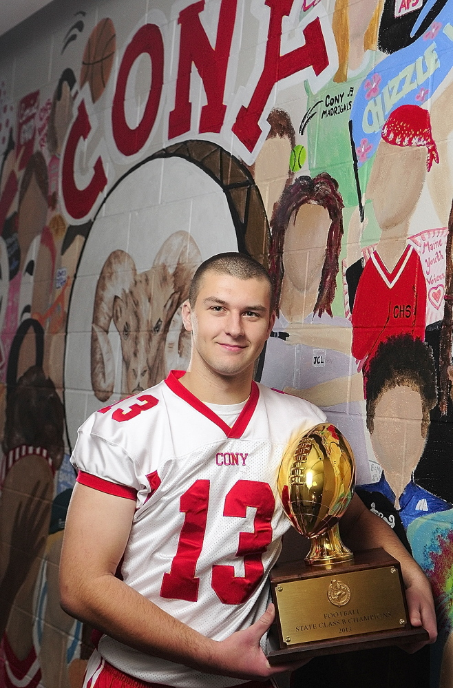 Staff photo by Joe Phelan 2013 Kennebec Journal Football Player of the Year Ben Lucas poses for a photo in front of Ramses mural on Friday December 6, 2013 at Cony High School in Augusta.