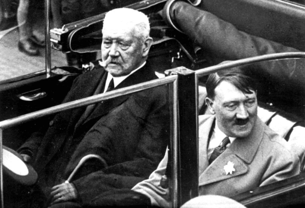 German President Paul von Hindenburg, left, and Adolf Hitler, right, in 1933. AP Photo