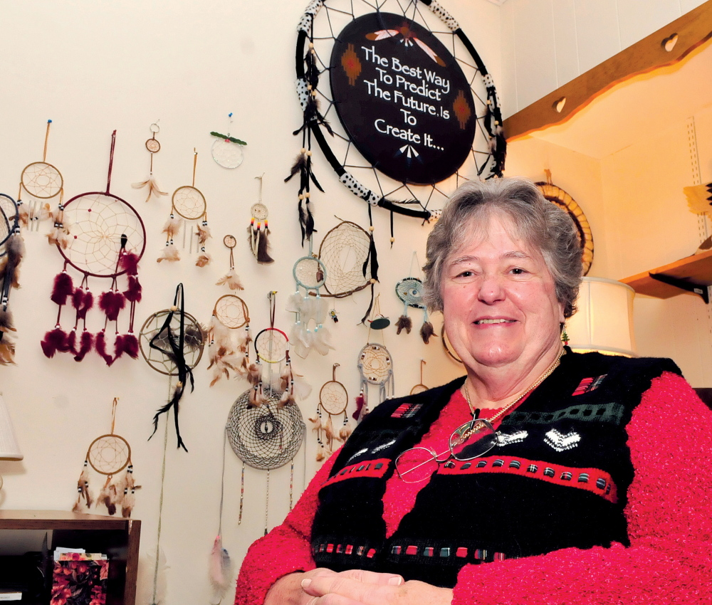 DREAM MAKER: Surrounded by a wall of dream catchers, REM Executive Director Faye Nicholson speaks about her 18 years at the organization in Waterville.