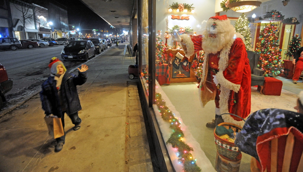 KRINGLEVILLE COMMUNITY: Thomas Turbovsky, 3, has an in-depth discussion with Santa Claus about his wish list during a visit to Kringleville at REM in downtown Waterville recently.