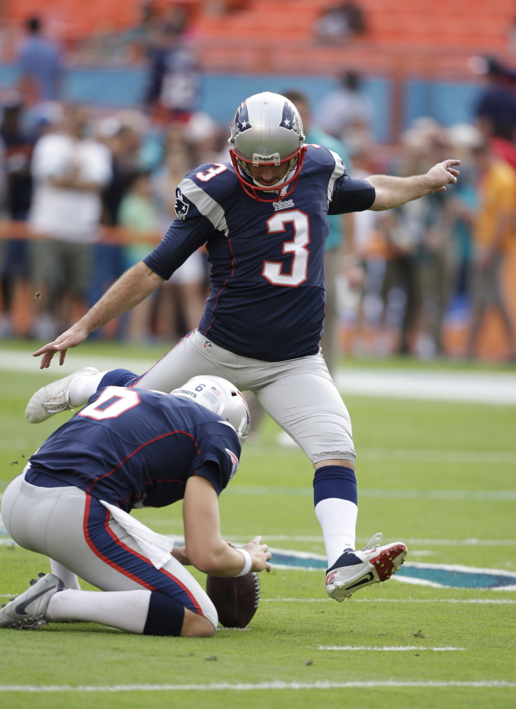 New England Patriots kicker Stephen Gostkowski (3) kicks the ball during practice as punter Ryan Allen (6) holds during practice before an NFL football game against the Miami Dolphins, Sunday, Dec. 15, 2013, in Miami Gardens, Fla. (AP Photo/Lynne Sladky)