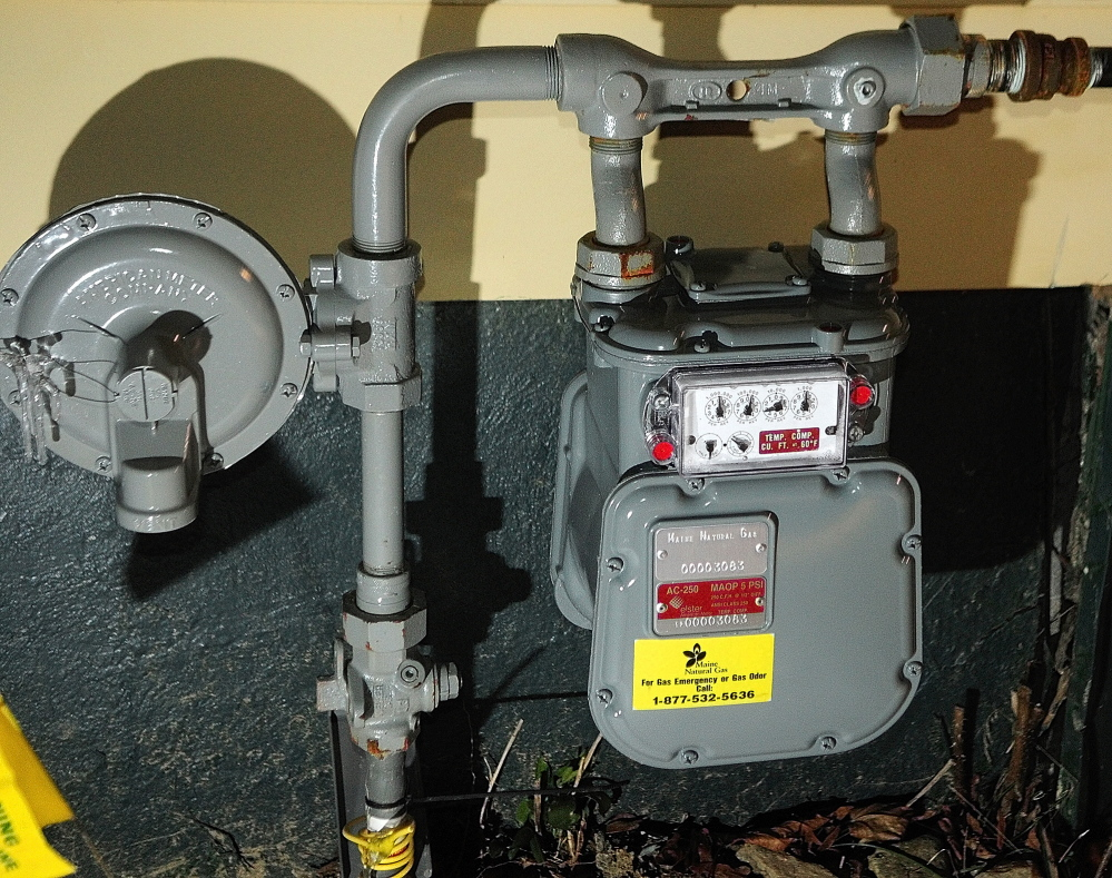 HEATING WITH GAS: an outdoor gas meter on the Augusta home of Dick Gagnon, who was one of the first in the area to switch from propane to natural gas.