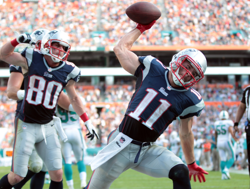 SPIKE THAT: New England Patriots wide receiver Julian Edelman (11) has 89 receptions this season, 20 more than his first four season combined. Edelman and the Patriots face Baltimore and will clinch the AFC East title with a win.