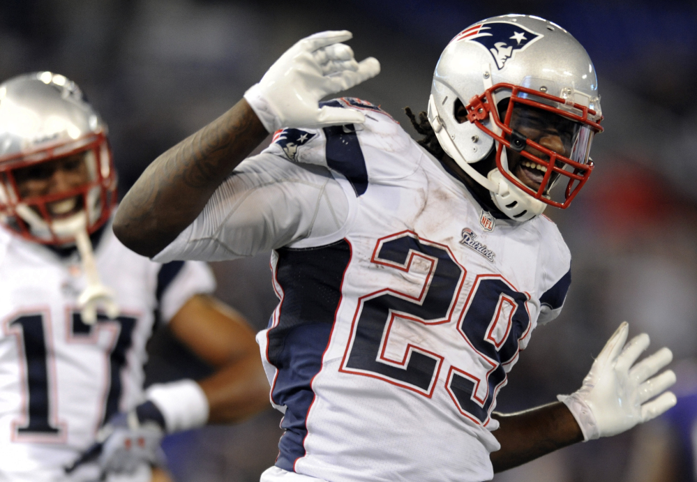 New England Patriots running back LeGarrette Blount (29) celebrates his touchdown in the second half of an NFL football game against the Baltimore Ravens, Sunday, Dec. 22, 2013, in Baltimore. (AP Photo/Gail Burton)