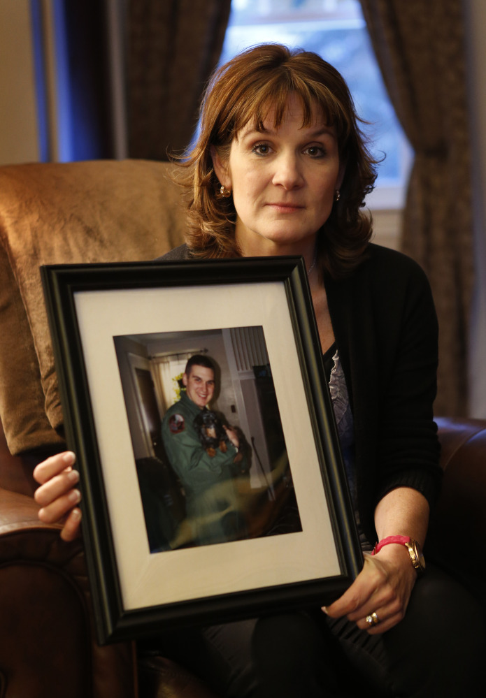 Hallie Twomey shows a photo of her son, C.J., at her home in Auburn. C.J. committed suicide three and a half years ago. Twomey is asking people to help scatter his ashes throughout the world so he can become part of the world he never got to see.