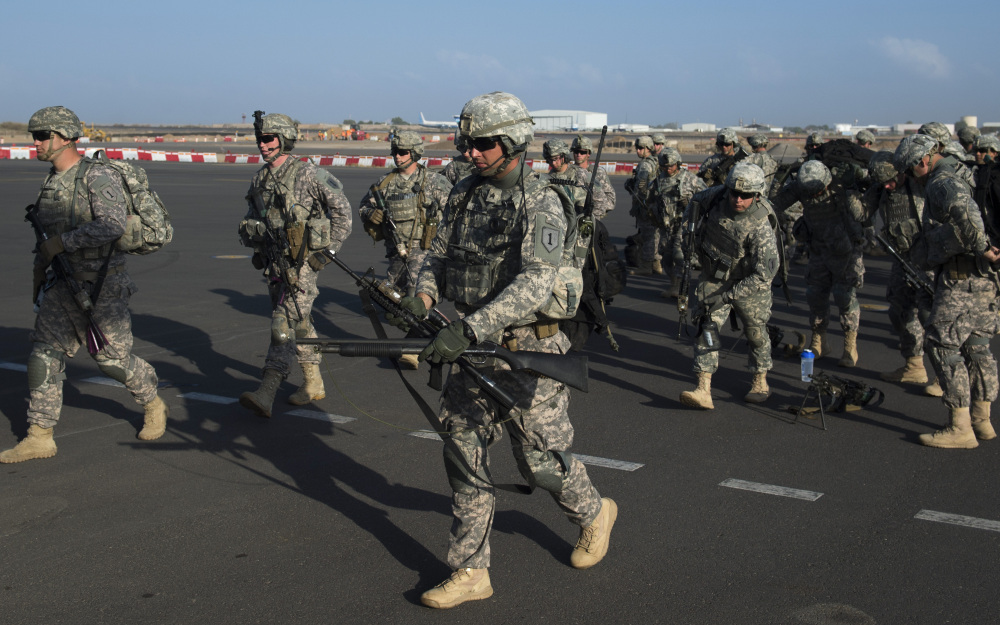 U.S. Army soldiers of the East Africa Response Force (EARF), a Djibouti-based joint team assigned to Combined Joint Task Force-Horn of Africa, prepare to load onto a U.S. Air Force C-130 Hercules at Camp Lemonnier, Djibouti.