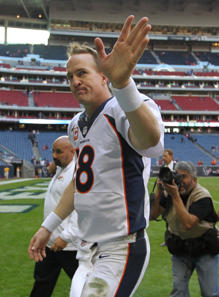 RECORD BREAKER: Denver Broncos quarterback Peyton Manning waves to the crowd after breaking the single-season touchdown Sunday the Houston Texans in Houston.