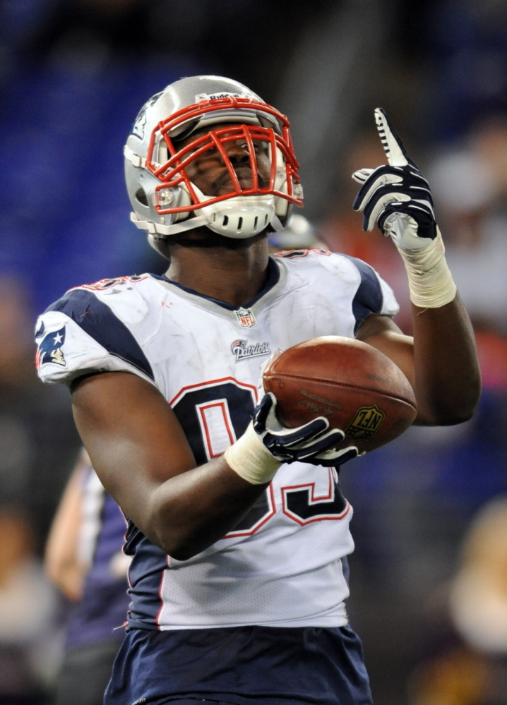 BIG PLAY: New England defensive end Chandler Jones celebrates after scoring a touchdown after he recovered a fumble in the second half of the Patriots' 41-7 win over the Baltiomore Ravens on Sunday in Baltimore.
