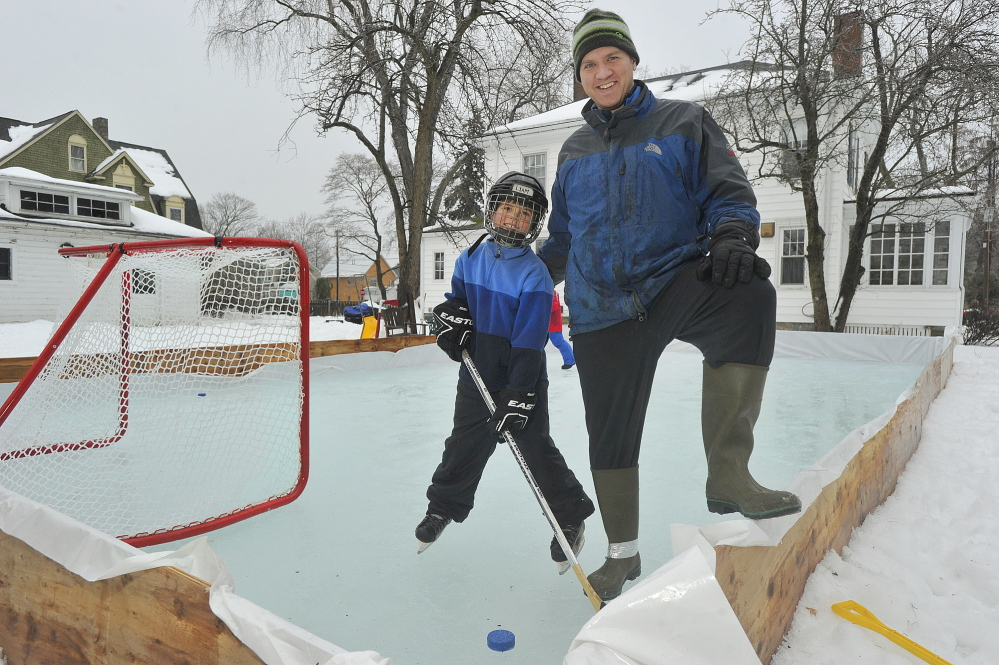 Gibson Fay-Leblanc and his son Liam enjoy the skating rink that Fay-Leblanc built in the backyard of his Portland home for his two sons.